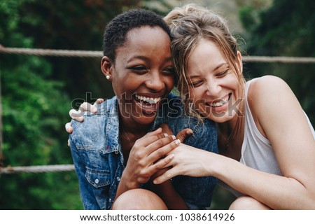 Happy friends holding each other