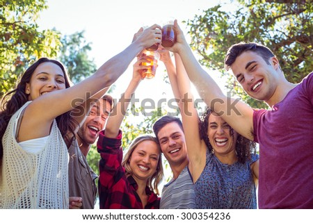 Happy friends in the park having beers on a sunny day #300354236