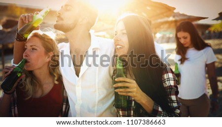 Happy friends laughing and smiling outdoors #1107386663