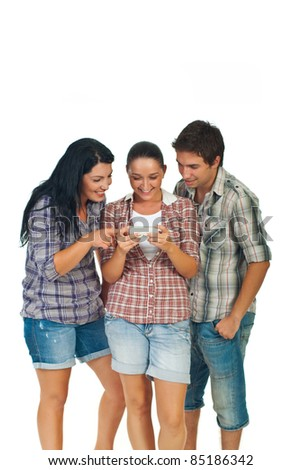 Happy friends playing game on mobile phone and having fun isolated on white background - stock photo