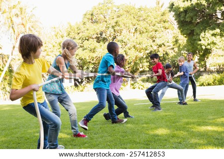 Shutterstock Happy friends playing in the park on a sunny day
