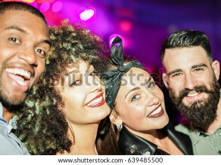 Happy friends taking selfie  in night club dance floor - Young people enjoying weekend nightlife and having fun together - Soft focus on right woman eye - Youth and concept - Unfiltered flash photo #639485500