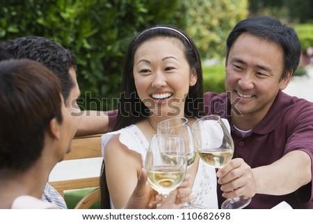 Happy friends tasting wine