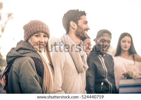 Happy friends walking in the city