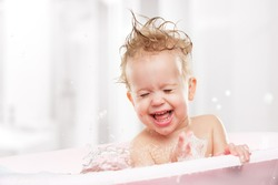 happy funny baby  laughing and bathed in the bath