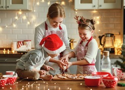 happy funny family mother and children  bake christmas cookies on cozy kitchen at home