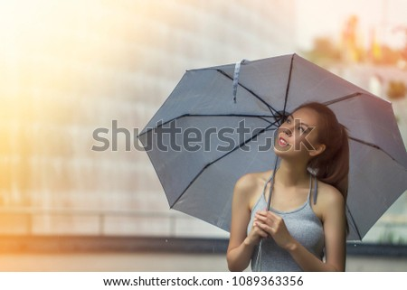 Happy funny woman with  umbrella under the rain shower and enjoying rainfall.  Walk in the park. #1089363356