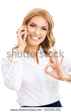 Happy gesturing young cheerful smiling business woman with phone or support operator, showing okay gesture, isolated over white background