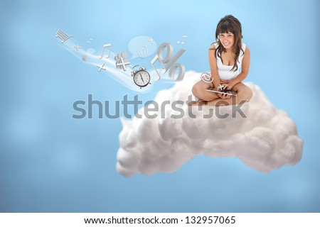 Happy girl connecting to cloud computing and accessing applications on blue background