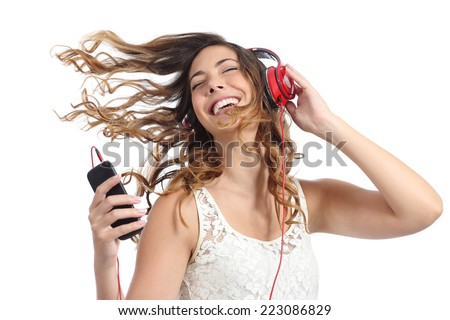 Happy girl dancing and listening to the music isolated on a white background #223086829