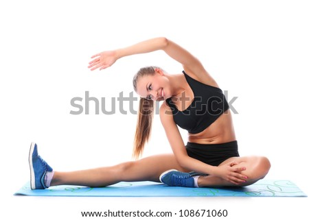 Happy girl doing fitness exercises over white background