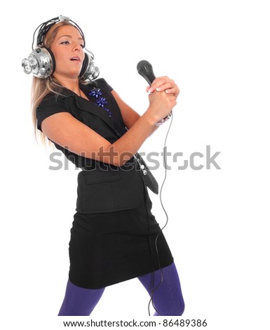 Happy girl enjoys listening music in headphones on a white background.