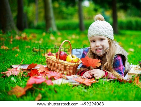 happy girl having a picnic in the autumn park