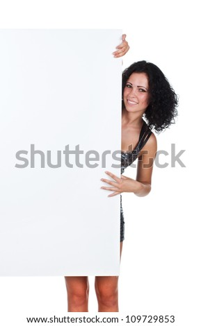 Happy girl holding a white banner and smiling