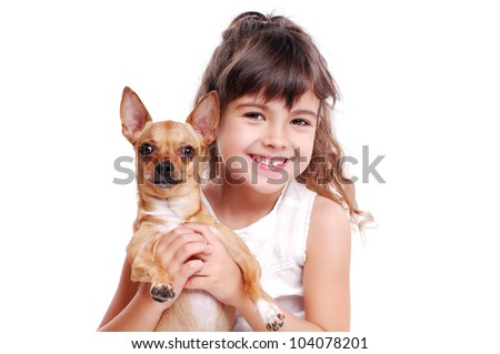 Happy girl holding her pet doggy