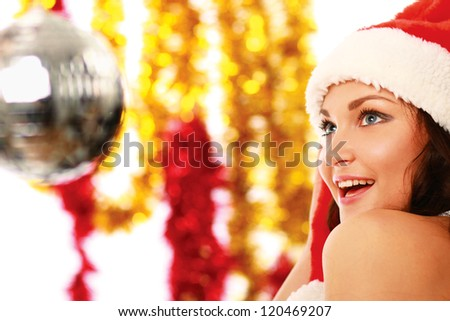 Happy girl in santa hat isolated on white background