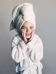Happy girl in SPA. Girl in a beauty salon.