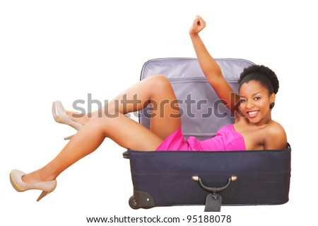 Happy girl in suitcase, going on a trip