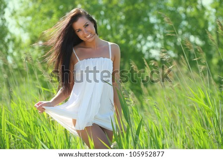 happy girl in white dress in the grass - stock photo