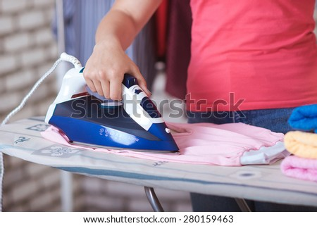 happy girl ironing clothes #280159463