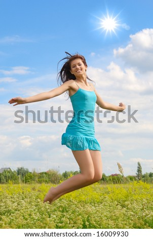 Happy girl jumping in the sky and laughing.