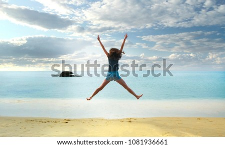 happy girl jumping on the beach, hands up #1081936661