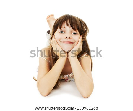 Happy girl lying on floor. Isolated on white background