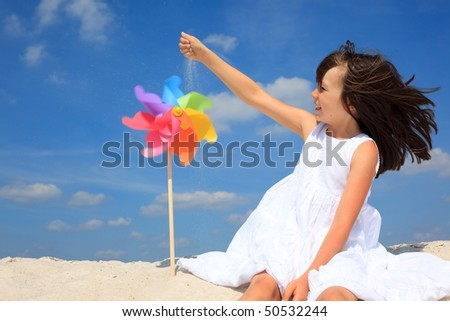 Happy girl on beach - stock photo