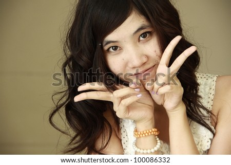happy girl playing with camera. - stock photo