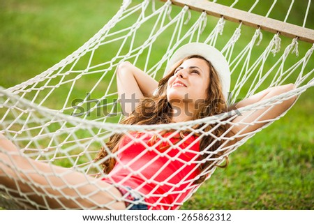 Happy girl resting in hammock