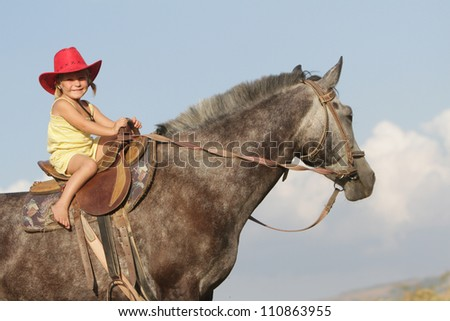 happy girl riding horse on natural background