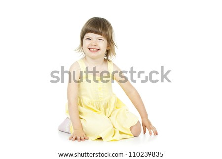 happy girl sitting isolated on a white background