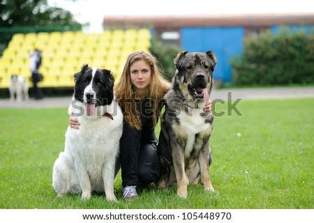 happy girl  sitting with  dogs