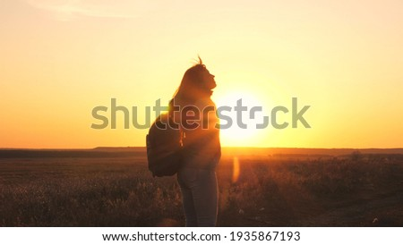 happy girl teen child closed her eyes dream. teenage kid wants a dream come true portrait at sunset. woman daughter silhouette dream of a happy childhood. free face sister closed eyes