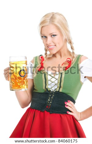 happy girl wearing a dirndl with beer mug over white