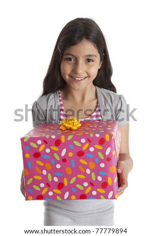 Happy girl with a a present on white background