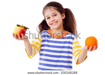 Happy girl with apple and orange, isolated on white