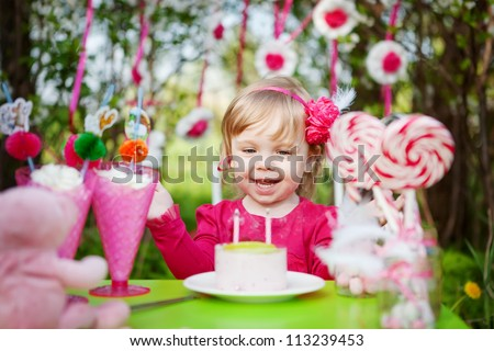 happy girl with birthday cake outdoors