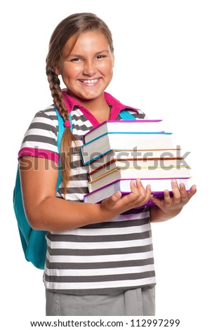 Happy girl with books isolated on white background
