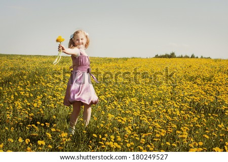 happy girl with dandelion outdoor