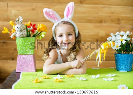 Happy girl with easter bunny ears celebrates easter emotionally