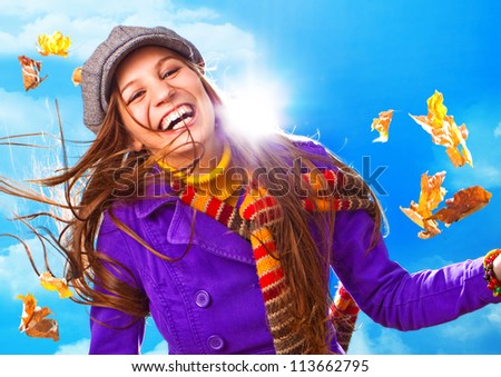 happy girl with foliage in autumn