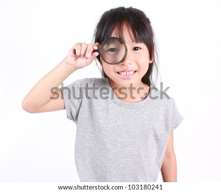 happy girl with magnifying glass