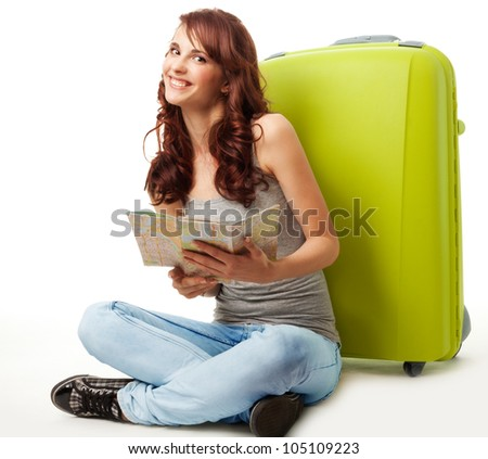 Happy girl with map and luggage and with big smile on her face