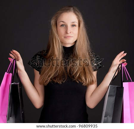 Happy girl with shopping studio photography