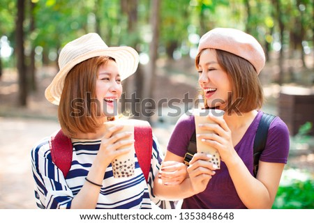 happy girls drinking bubble tea and enjoy summer vacation  #1353848648