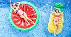 Happy girls floating with tropical fruit lilos inside swimming pool - Young women friends relaxing in summer vacation at resort hotel - Travel, chilling, holidays, youth concept - Warm filter