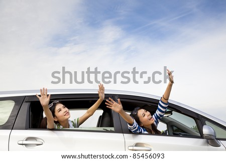 happy girls in the car and enjoy vacation