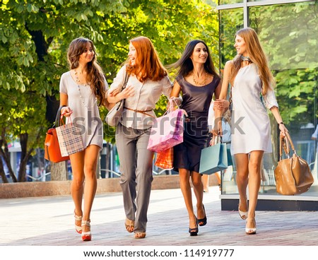Happy girls out shopping