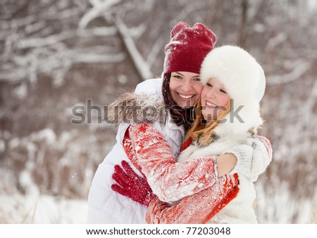 Happy girls plays with snow at winter park